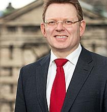 Andreas Hollstein1 210x220 - Hon. Andreas Hollstein
