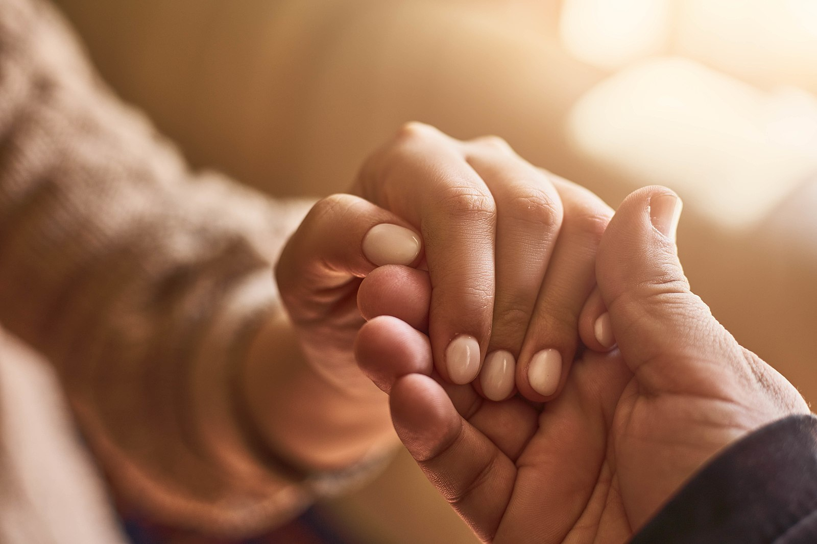 1600px Compassion holding hands - This Week in Partnerships: Our Favorite Cross-Sector Stories - January 22